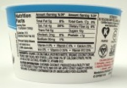 Image shows ingredients and nutrition label for sweetened SoDelicious plain yogurt, as described in this post on CALMERme.com