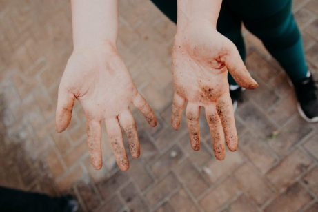 Dirty hands held in front of the camera. Contamination OCD can include excessive hand washing, cleaning, sanitizing, avoidance, and reassurance. Get OCD treatment in California or online OCD counseling in Montana here.