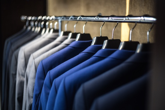 Suits neatly aligned in a closet. Many people falsely believe OCD is just about having your life clean and in order. In reality, OCD is a fear based disorder that can be debilitating.