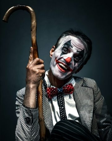 """Man in clown make up. The fear of clowns is a common fear that tends to be exacerbated through media's common use of the """"Killer Clown"""" trope. The California OCD and Anxiety Treatment Center treats all phobias and fears in Fullerton, as well as through online therapy, group therapy, and intensive out-patient treatment in Orange County, California."""