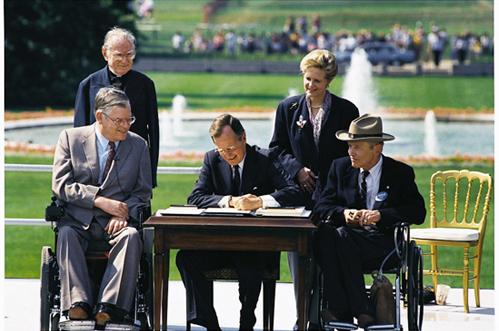Bush_signs_in_ADA_of_1990.jpg