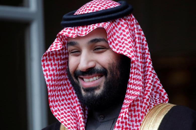 Saudi Arabia's Crown Prince Mohammed bin Salman poses as he arrives at the Hotel Matignon in Paris