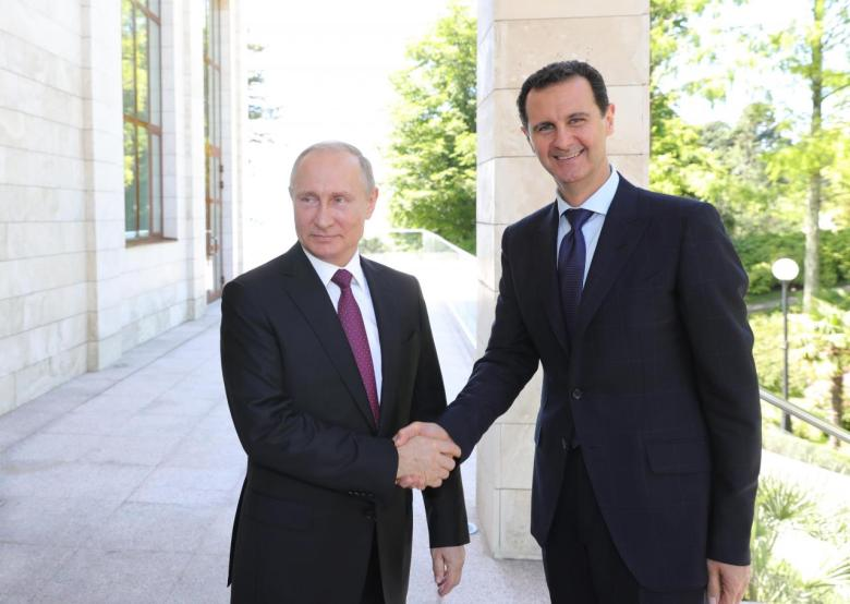 Russian President Putin welcomes Syrian President Assad during their meeting in Sochi