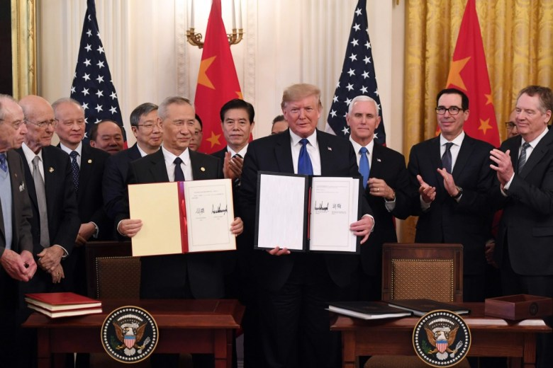 "President Trump and Vice Premeier Liu He sign a ""phase one"" trade deal at the White House in January 2020."