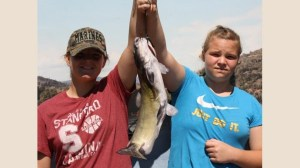 Kayla and Olivia with catfish