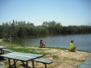 Kids enjoying the fishing pond at the Raahauge Shooting Fair last month. (RACHEL ALEXANDER)