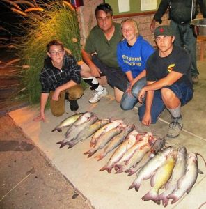 El Cajon's Brian, Daniel and Grace Martin teamed with Chris Flor to catch 15 catfish totaling 60 pounds, using mackerel. (LAKE JENNINGS)