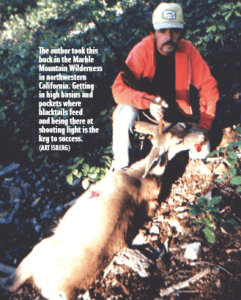 The author with a buck he shot