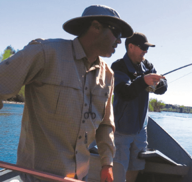 Shane Kohlbeck instructs the author's friend Chris Barnes on landing one of many lower Sacramento rainbows the trio pulled in while ?y ?shing with the Redding-based guide. (JEFF LUND)