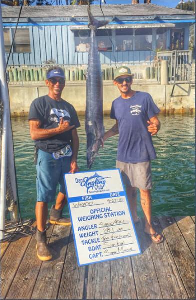 Capt. Shane Mansur and angler Steve Khachadoorian weigh in Steve's wahoo caught aboard the Sum Fun.