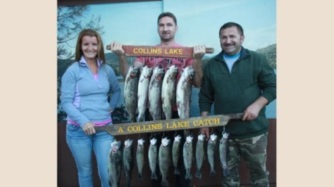 Cory, Paul and Vasile with a stringer full of trout.