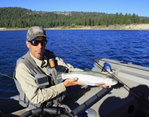 Author Jon Baiocchi with an average Davis Lake rainbow, healthy fish that measure about 18 to 20 inches. (LANCE GRAY)