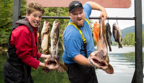 Rivers Inlet Sportsman's Club fishing lodge owner's son Kieran and his monster 30-pound lingcod, caught on July 25. (RIVERS INLET)