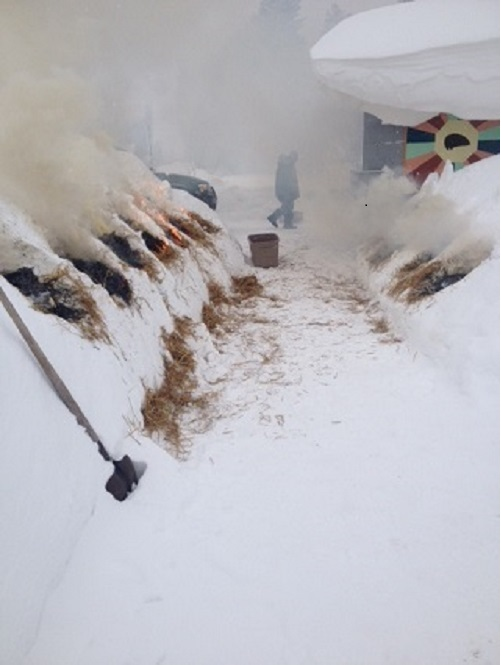 Last winter's snow bank smoke firing.