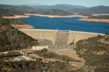 Aerial view of Lake Shasta & dam with low water.
