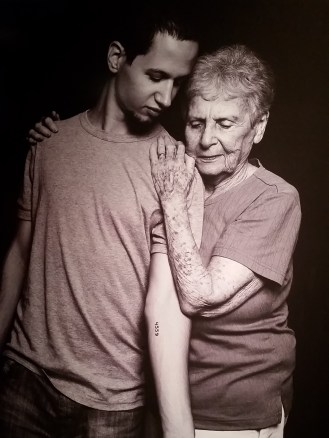 Photograph by Uriel Sinai of Daniel Philosoph and Livia Ravek. Israelis have voluntarily gotten tattoos of their relatives' imprisonment numbers as a symbol of remembrance and honor.