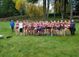 Camas ladies hold their coach, Laurie Porter, after their last race of the season