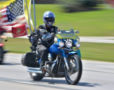 Participant of the thrid End of Watch rides by on Highway 49 on April 22, 2017.