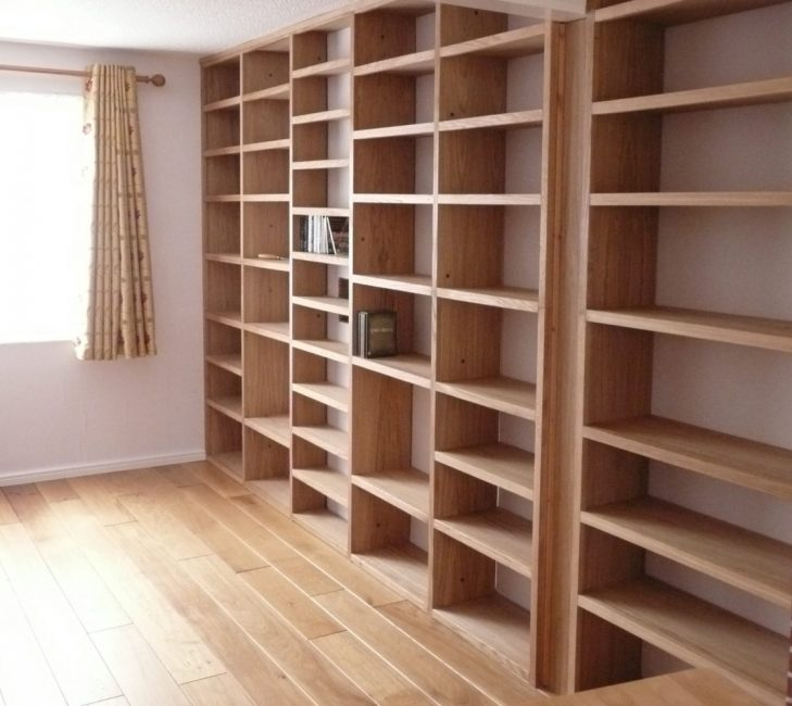 Oak Shelving constructed in module form to avoid the appearance of seams .