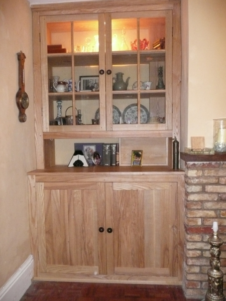 Ash cabinet fitted in irregular alcoves