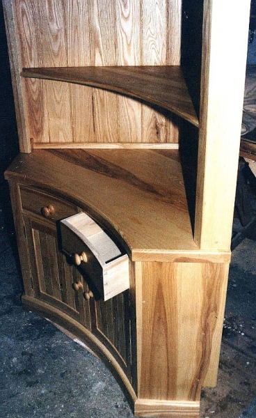 Steamed ash corner unit with a concave face