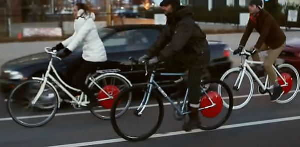 Copenhagen Wwheel promotional video shows bicyclists riding in the door zone