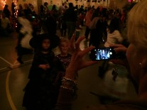 Ms. Vogstad snaps a photo at the Halloween Dance.