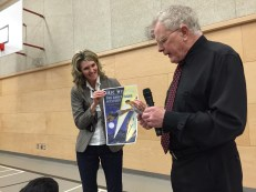 Author Eric Wilson presents Ms. Turner with a gift
