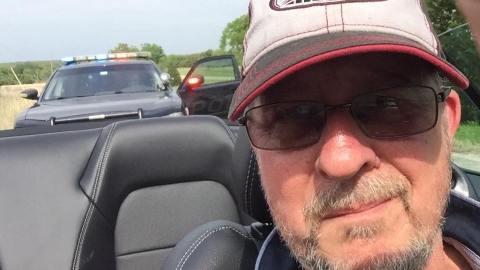 Reeves selfie with patrol cop