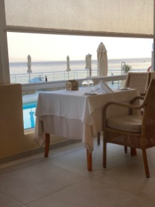 Restaurant tables with pool & sea view