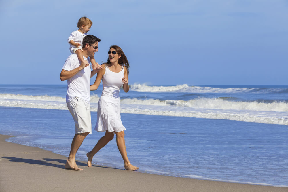 family-on-beach-wearing-white-clothes