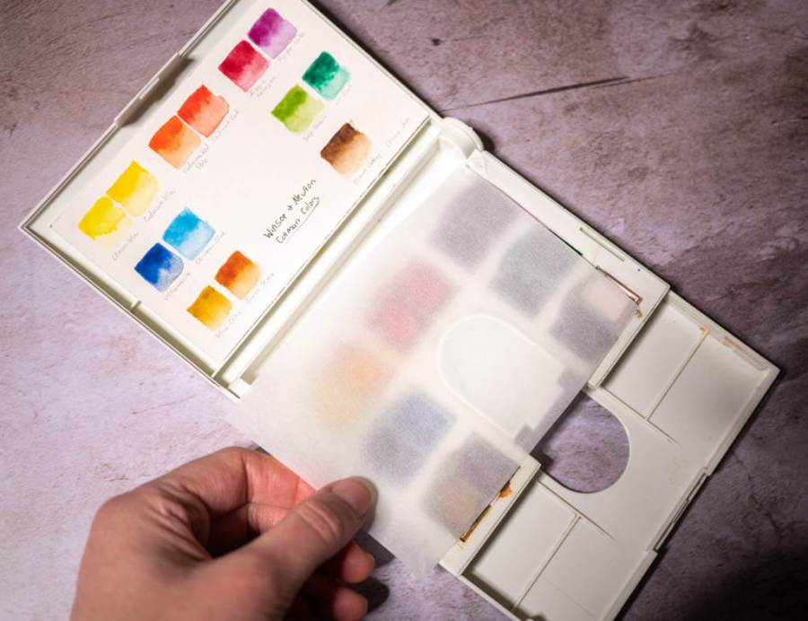 Winsor Newton Cotman homemade color chart with wax paper overlay to protect paints