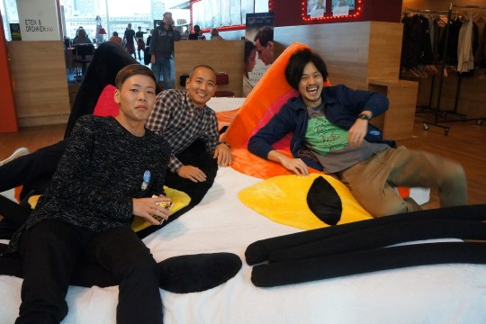 CAMERA JAPAN 2016 - Directors KAWAI Ken, SUGITA Masakazu, and MIMA Akihiro enjoying the cat sofa.