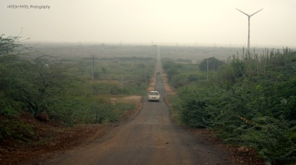 Almost 15 kms of straight road with farm lands on both sides