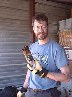 Brent holds up one of the completely rotted away spray cans