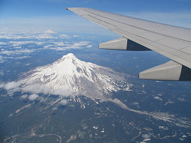 View of Mt St Helens and Rainier from the airplane window, photograph by Brent VanFossen