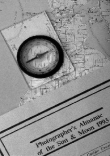 photograph of maps and compass