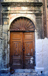 Old wooden decorated door on abandoned building, Tel Aviv, Israel, photograph by Brent VanFossen