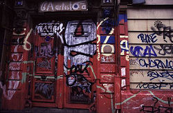Grafiti covered door in an abandoned building, Paris, France, photograph by Brent VanFossen