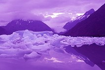 The computer couldn't handle the soft blue colors of this sunset over Portage Lake, Alaska, and turned it surreal purple colors. Click to see the original. Photo by Brent VanFossen