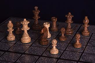 hand-carved wooden chess pieces