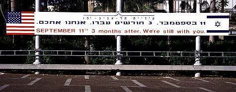 Sign in Rabin Square, Tel Aviv, says Sept 11, three months after and we are still with you. Photo by Lorelle VanFossen