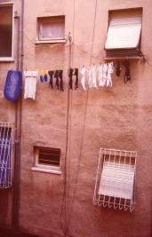 Bras line the wall as neighbors dry their laundry, photo by Brent VanFossen
