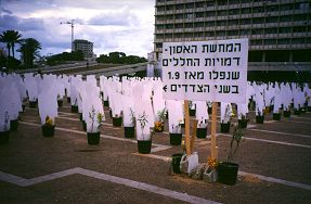 White plastic silouettes mark the number killed in the Intifada in Israel, photo by Lorelle VanFossen