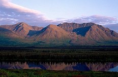 Wide Angle View of Alaska Mountain Range and water reflection, photography by Brent VanFossen