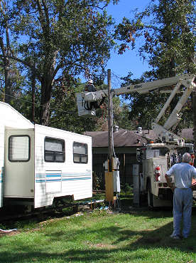 Alabama Power snorkel moves out over our trailer to replace power cable, photograph by Lorelle VanFossen
