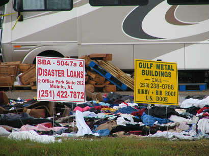 Signs sit with clothing dumped for donations