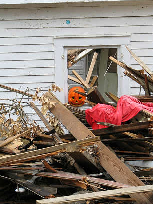 Pumpkin sits in the window of a destroyed home in Ocean Springs, mississippi