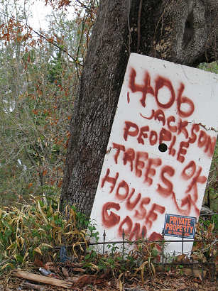 Sign reads - People Trees Okay - House Gone