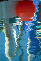 Reflection of a bouy in water, photograph by Brent VanFossen